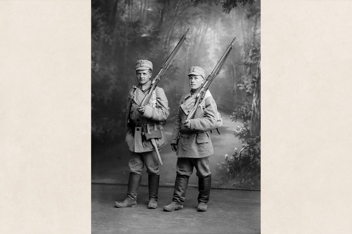 Two soldiers photographed in an atelier, 1918. Finnish boots as military uniform footwear. Photo: Victor Barsokevitsch / KUHMU