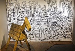 Rangaistuskeinona käytetty puuhevonen piirroskuvan edessä. Piirroskuvassa erilaisia rangaistuskeinoja.